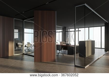 Corner Of Modern Ceo Office With Gray And Glass Walls, Wooden Door, Comfortable Computer Table With