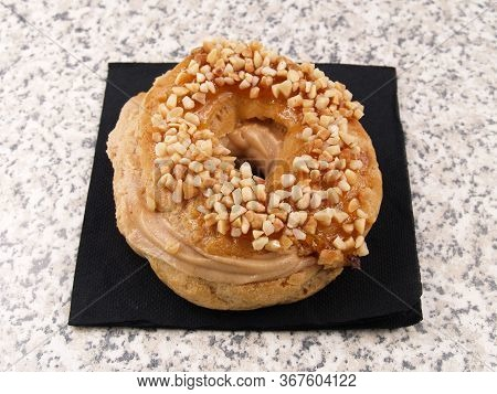 French Donut With Nuts And Praline\nfrench Donut Called Paris Brest French Dessert Choux Pastry And