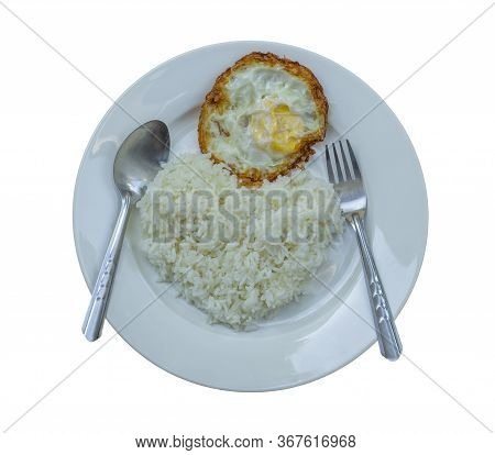 Fried Crispy Egg On Parboiled Rice In A Separate White Plate On A White Background. Heart Shaped Ric