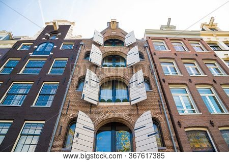 Facade Of Traditional Amsterdam Houses. Windows Detail.