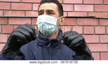 Masked Man Wearing Boxing Gloves, Getting Crazy, Trying To Protect Himself From Invisible Threat, Hy