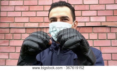 Masked Man Wearing Boxing Gloves, Getting Crazy, Trying To Protect Himself From Invisible Threat, Fi