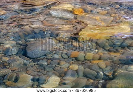 Stones In The Water. Blue Sea Water Splash. Background Of Sea Water. Natural Stone Closeup Backgroun