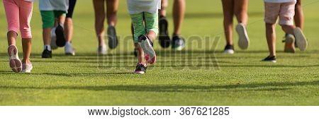 Running Children, Young Athletes Run In A Kids Run Race, Running On Grass Detail On Legs, Running In