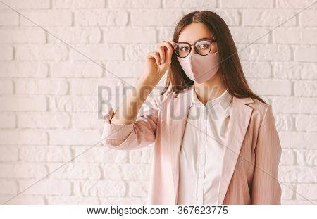 Portrait Beautiful Professional Business Woman In Pink Protective Face Mask, Casual Suit And Eyeglas