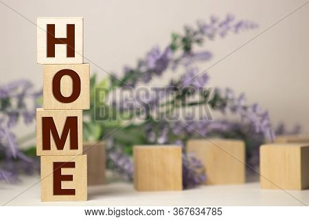 Isolated Over White, Rough Wooden Blocks Spelling The Word Home Intentionally Grungy