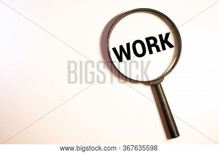 Magnifying Glass Over The Word Job Wooden Letters On Yellow Background. Top View, Flat Lay.