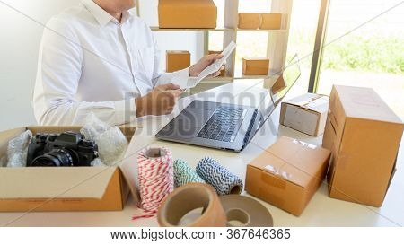 Delivery Business Small And Medium Enterprise(smes) Workers Packaging Box In Distribution Warehouse
