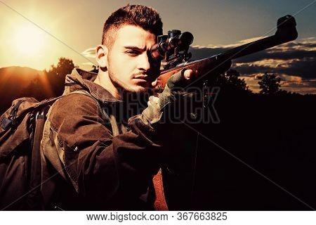 Hunter With Shotgun Gun On Hunt. Track Down. Hunting Gear And Hunting Clothing