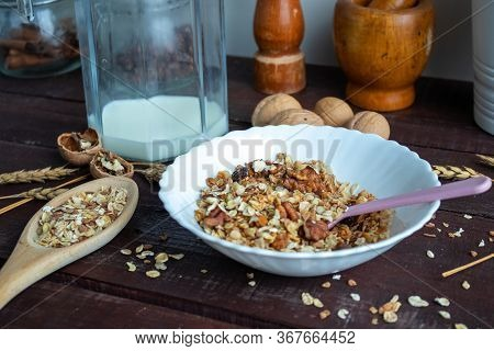 Healthy Lifestyle. Healthy And Nutritious Muesli In A Plate. For Breakfast-natural Muesli With Nuts.