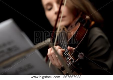 Woman Playing A Classical Violin During A Recital