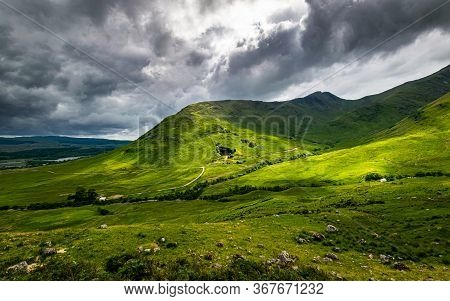 Scottish Highlands Summer Landscape In Glen Strae. Green Valley With Dramatic Storm Clouds Near Dalm
