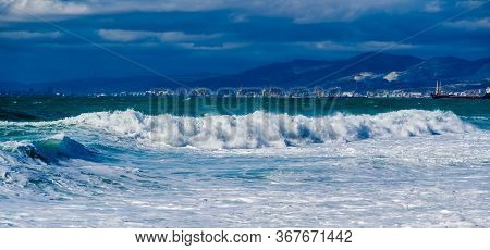 Storm And Storm In The Black Sea. Emerald Storm Waves From The Snow-white Sea In The Waters Of The T