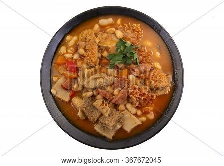 Traditional Portuguese Dish Using Ox Honeycomp Tripe And Cannellini Beans In A Hearty Stew.