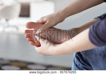 Closee Up Woman Doing Self Foot Massage For Pain Relief After Fatigue, Long Walking, Working, Standi