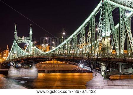 Budapest, Hungary - February 22, 2016: Night View Of Liberty Bridge - Freedom Bridge In Budapest, Hu