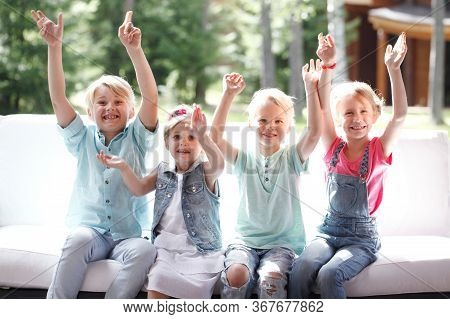 Image Of Happy Children Friends Raising Arms And Screaming In Joy