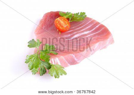 raw tuna steak isolated on white background