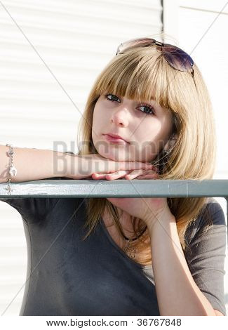 Girl Against Bright Urban Background