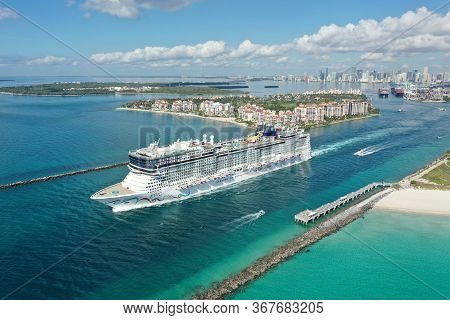 Miami Beach, Florida - May 23, 2020 - Aerial View Of Cruise Ship Leaving Port Miami During Coronavir