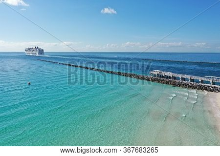 Miami Beach, Florida - May 23, 2020 - Aerial View Of Cruise Ship Leaving Port Miami During Coronavir