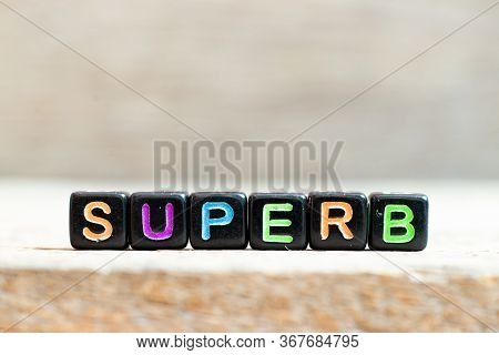 Black Bead With Color Letter In Word Superb On Wood Background