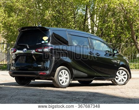 Novosibirsk/ Russia - May 03 2020:   Black Toyota Sienta,  Back View.  Modern  Minivan Made In Japan