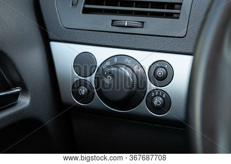 Novosibirsk/ Russia - May 03 2020:  Opel Astra,  Close-up Of Black Of Headlight Buttons On Car Panel