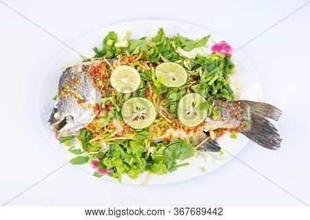 Steamed Sea Bass In Lemon On Dish Isolated On White Background