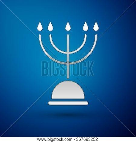 Silver Hanukkah Menorah Icon Isolated On Blue Background. Hanukkah Traditional Symbol. Holiday Relig