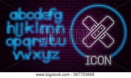 Glowing Neon Line Crossed Bandage Plaster Icon Isolated On Brick Wall Background. Medical Plaster, A