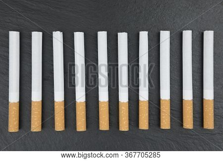 Stack Of Cigarettes Close Up As Background