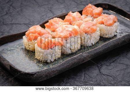 Sushi Set Served On Dark Background. Baked Maki Roll, Philadelphia Maki With Masago, Salmon, Cream C