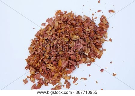 Peanut Husk Top View. A Pile Of Peanut Husks On A Gray Background. Peel From Nuts, Fertilizer For Th