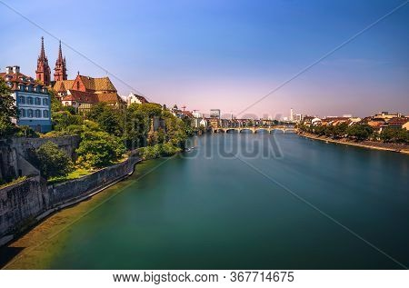 View Over The Old Town Of Basel, Munster Cathedral And The Rhine River In Switzerland. Long Exposure