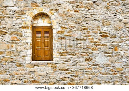 Wall With Shuttered Window. Surface With Asymmetrical Stones. Window On Stone Wall. Wall Pattern Tex