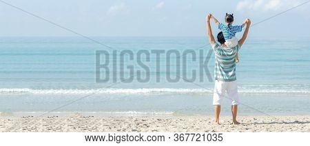 Asian Happy Family Have Fun Fly On The Beach For Leisure And Destination.  Family People Father And