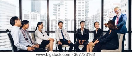 Businessman Coach Speaker Presentation And Discussing Meeting Strategy Sharing Ideas Thoughts And Co