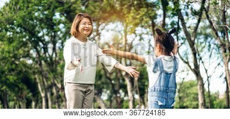 Portrait Of Happy Grandmother And Little Cute Girl Enjoy Relax Together In Summer Park,little Girl R