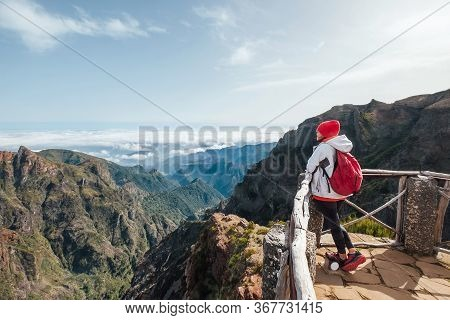Young Female Backpacker Enjoying Mountains View While Trekking By Famous Mountain Footpath From Pico