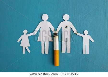 Paper Cut Of Family Destroyed By Cigarettes. Drugs Destroying Family Concept. Quit Smoking For Life