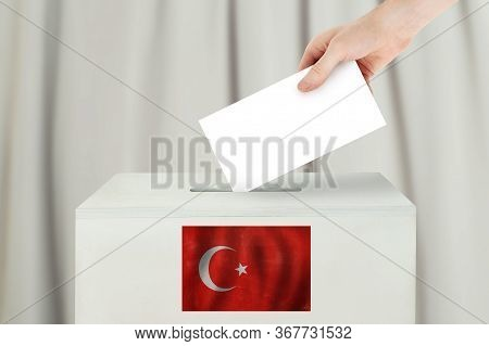 Turkey Vote Concept. Voter Hand Holding Ballot Paper For Election Vote On Polling Station