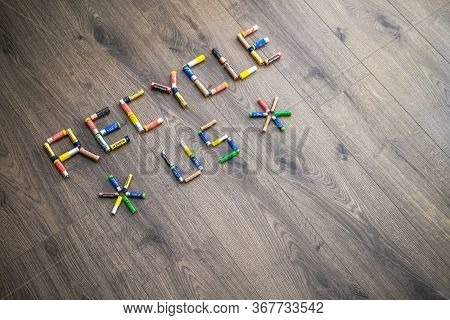 Adelaide, Australia - July 7, 2019: Recycle Us Text Made Of Used Aa And Aaa Batteries On Wooden Back
