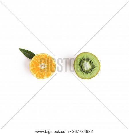 Food And Fruit Concept - Cut Of Mandarine And Kiwi. Top View Or Flat-lay. Copy Space. Isolated On Wh