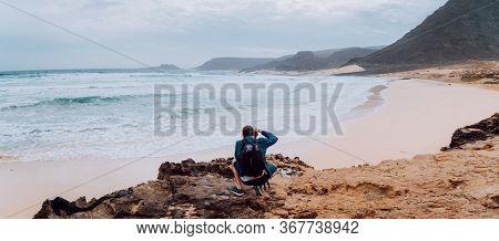 Calhau, Sao Vicente Island Cape Verde. Photographer With Camera In Desert Admitting Unique Landscape