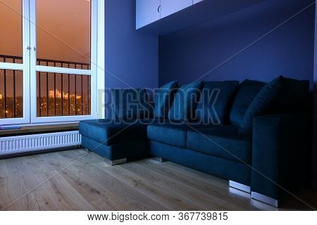 Interior Empty Room After Repair, Sofa And Window. Design Stylish Living Room. Original Trends And C