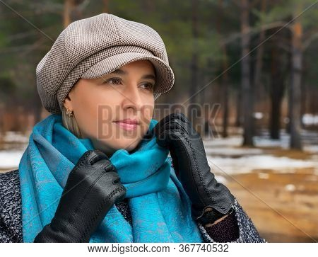 A Young Happy Girl In A Grey Coat And Cap And A Blue Stole.girl In The Autumn Forest In The Fresh Ai