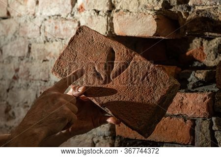 Man Worker Reconstructing Old Stone Wall