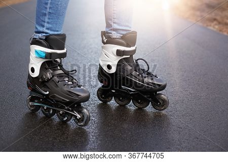 Outdoor Picture Of Roller Blades, Being Testified By Unknown Person, Being In Middle Of Road, Tool F