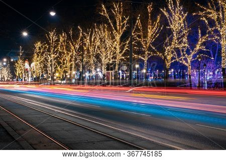 Christmas City Street Transport Motion Colorful Illumination Lighting From Car Headlights And Trees